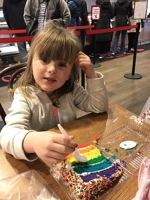 Megan eating Carlo's bakery cake